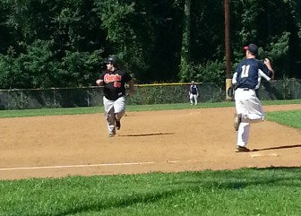 Sean playing baseball
